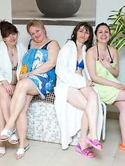Group of matures relaxing in the sauna