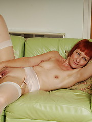 Horny mature slut playing alone on the couch