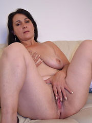 Horny mature slut playing with herself on the couch