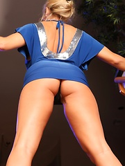 MILF Amber Lynn Bach strips from her sexy blue dress and spreads her sexy legs wide.