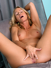 Sex starved Simone Sonay gets satisfied by fingering her mature twat